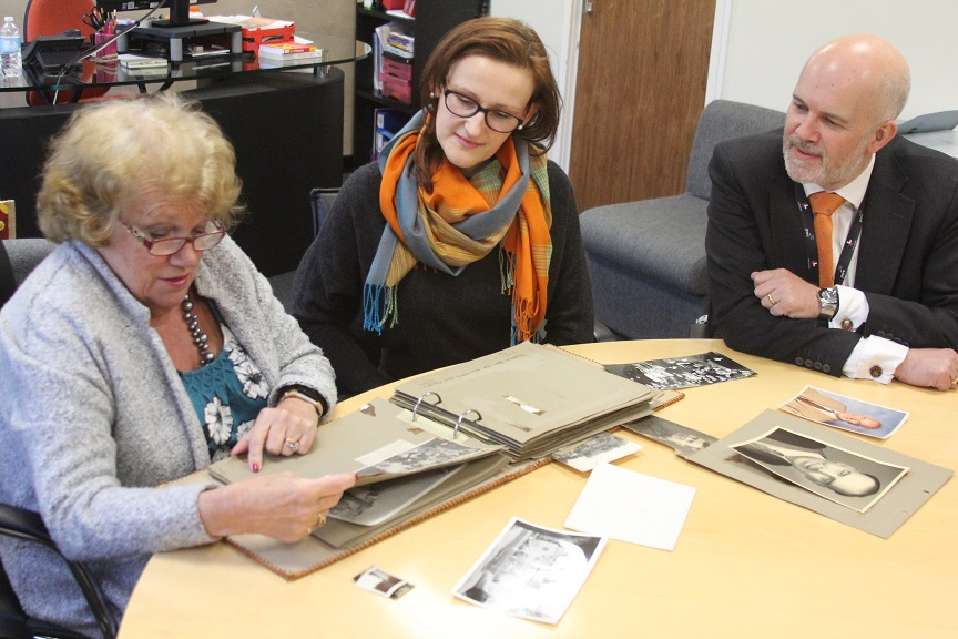 Izabela meets with Mr Philpott's daughter-in-law, Kath and grandson Neil – who is the chair of Fairfax's current board of governors – to look at family photographs to inspire the painting.