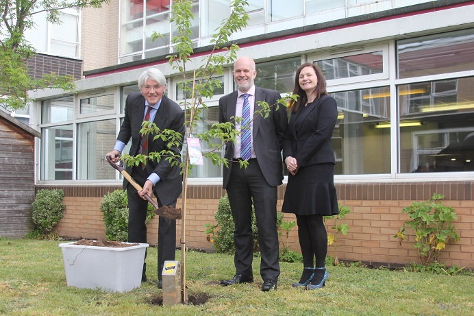 Sutton MP Andrew Mitchell plants the tree watched by Fairfax Head of Academy Deborah Bunn and Neil Philpott, chairman of the Academy Association and grandson of the school's founder.