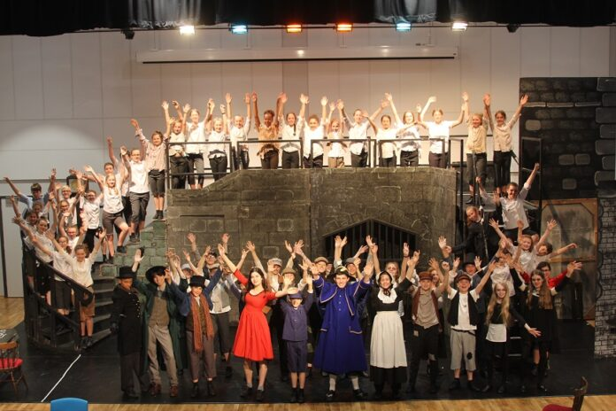 The entire cast of Plantsbrook School's ambitious production of Oliver!