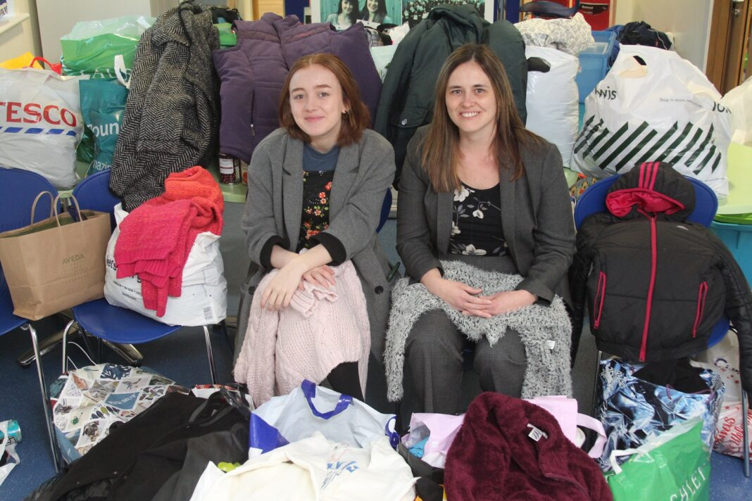 Sutton Girls' sixth-former Maryam Mohanna with assistant headteacher Michelle Lucas and just some of the clothes collected for People in Motion.