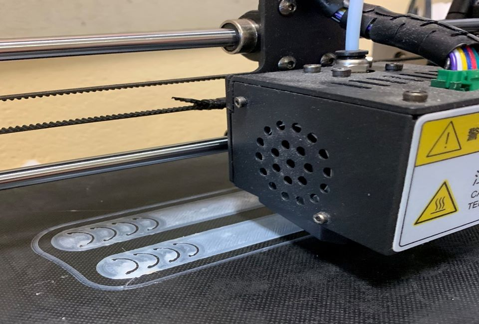 Arthur Terry's 3D printer making clips for face masks.