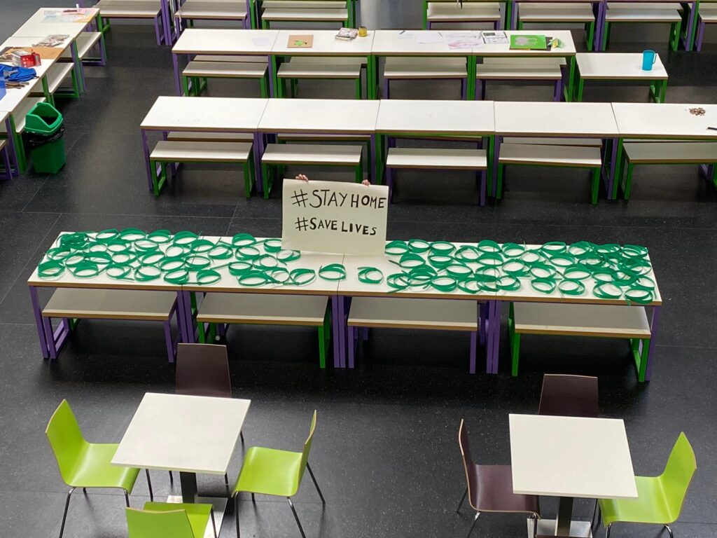 A table at Plantsbrook School covered in parts for NHS face visors that have been made by staff.