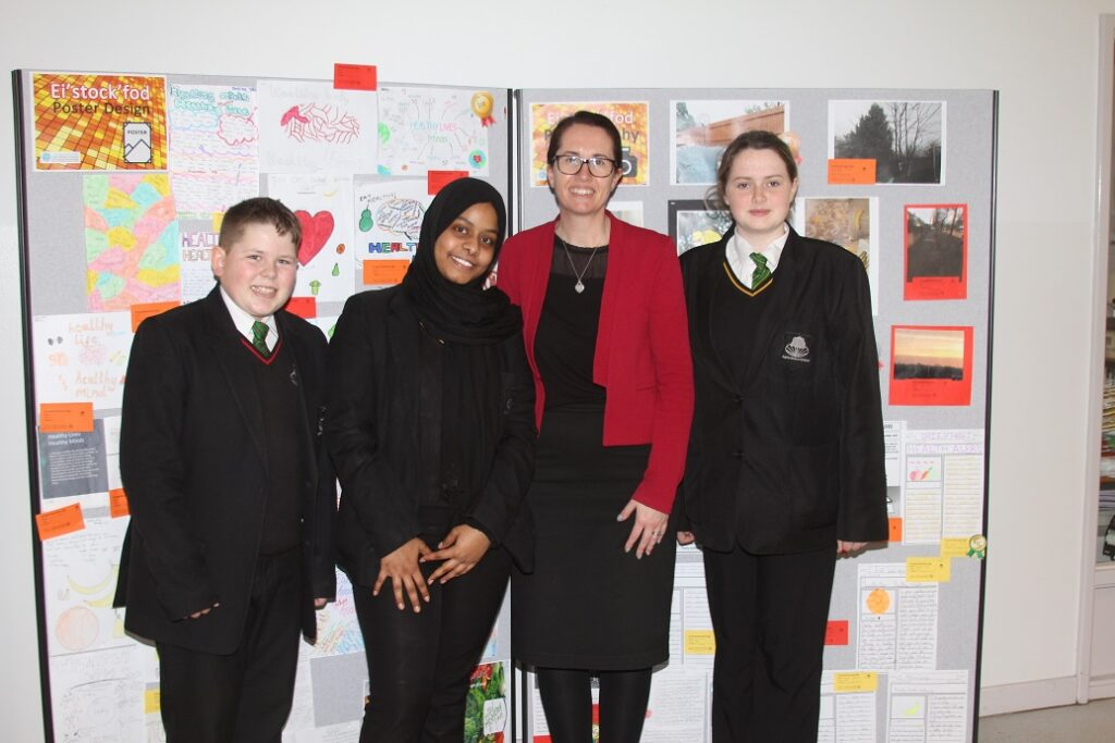 'Ei-Stock-Fod' winners Alexandru Harbea, 12, and Weam Ahmed, 14 and Madeline Cotterill, 13 with headteacher Marie George.
