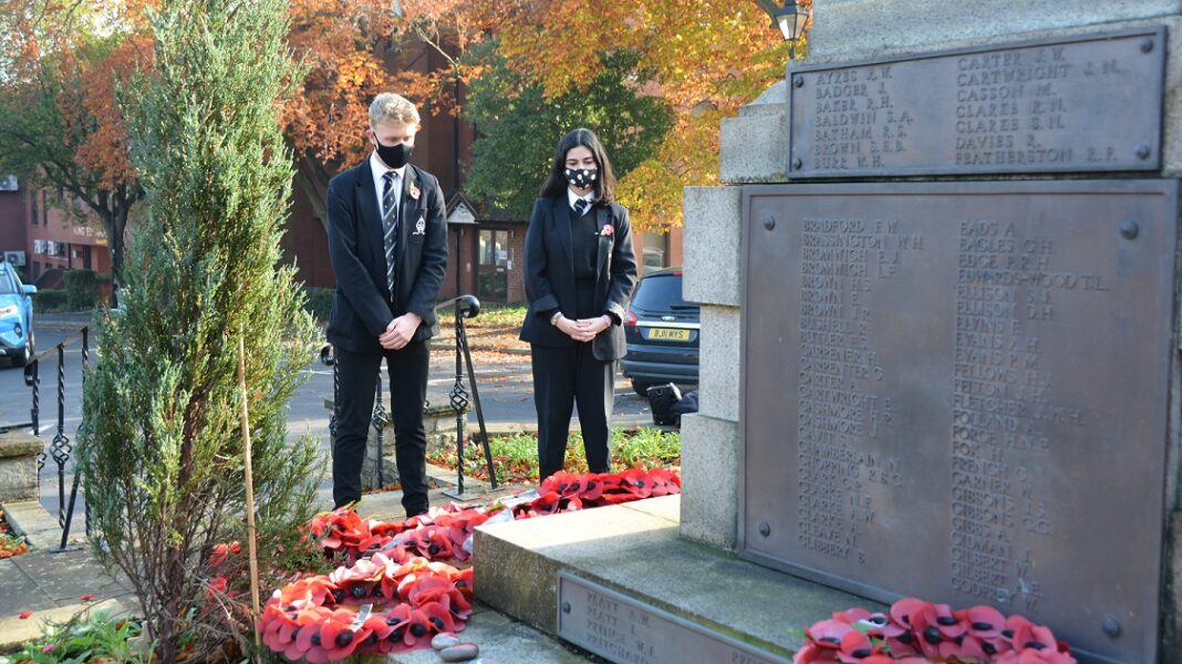 Students from Bishop Vesey's Grammar School pay their respects at Sutton Coldfield's war memorial.