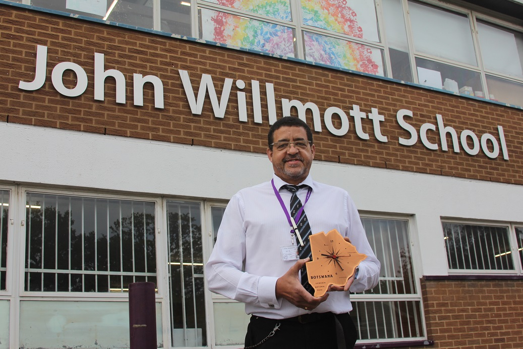 Time to fly: John Willmott School's Phil Fergus with a clock shaped like Botswana, where he worked in schools for 15 years.