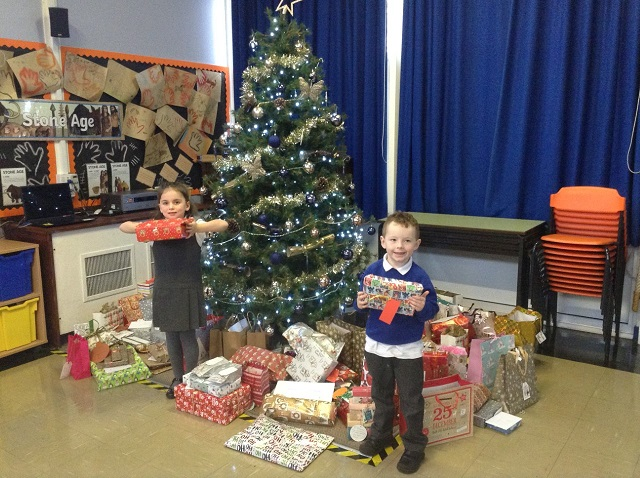 Reception children at Curdworth Primary School with some of the gifts for residents at Orchard Blythe Nursing Home in Coleshill.