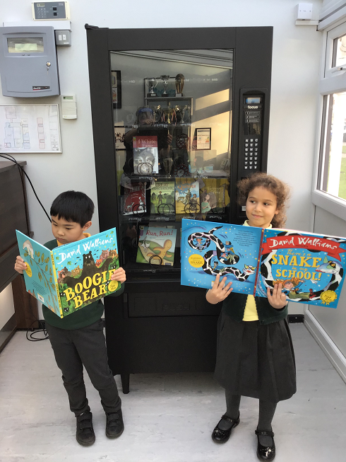 Mere Green pupils Hannah and Louis enjoy some of the books.