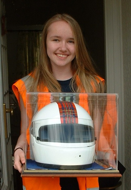 Charlotte with the trophy, which is a crash helmet that belonged to motorsport star David Leslie who died in 2008.